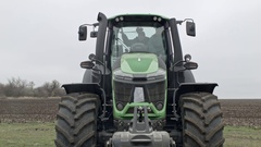 Tractor driver is turning machine headlights on Stock Footage