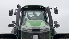 Tractor driver is turning machine lights on Stock Footage