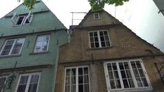 4k Antique house front souvenir shop tilt down city Bremen famous area Schnoor Stock Footage