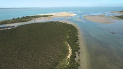 Backward flight above shallow water at Rhyll Inlet, Phillip Island Stock Footage