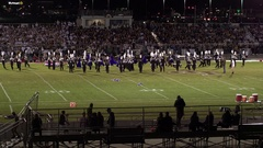 Aerial pan of high school high school band playing Stock Footage