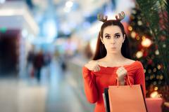 Funny Woman with Christmas Reindeer Horns Headband Shopping Kuvituskuvat