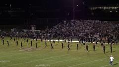 Aerial pan of high school cheerleaders dancing Stock Footage