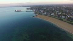 Dynamic aerial shot of Brighton Beach coastline with Melbourne CBD Stock Footage