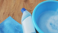 Basin with soap water, detergent and cleaning rag Stock Footage