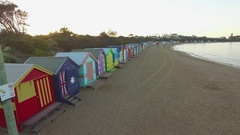 Slow rise close to the row of Brighton Beach bathing huts with camera tilt Stock Footage