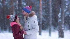 Happy winter couple in love under harsh snowfall Stock Footage