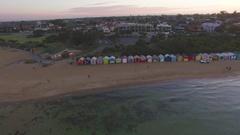 Flight along the Brighton Beach bathing boxes at sunrise Stock Footage