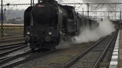 Old vintage Steam Train Leave Train Station in Prague Stock Footage