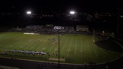 Rising view of high school football game at night Stock Footage