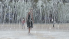 Girl dancing at the fountain Stock Footage
