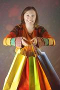 Shopping woman holding shopping bags. Stock Photos