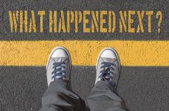 What happened next?,  print with sneakers on asphalt road. Stock Photos