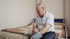 Elderly Man Measuring Blood Pressure Stock Footage