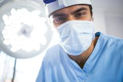 Male surgeon wearing surgical mask Stock Photos