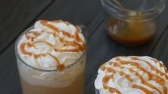 Caramel latte with whipped cream and salt Stock Footage