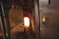 Glass heated in glassblowers  oven Stock Photos