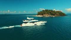 Aerial: Beautiful luxury boat sailing near the island. Stock Footage