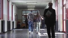 Group students Walking along hallway Stock Footage