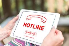 Hotline concept on a tablet Stock Photos