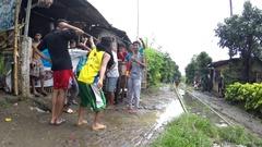Young teenage boys dancing along wet muddy railroad tracks Stock Footage