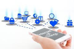Internet of things concept with smartphone and different apps icons Stock Photos