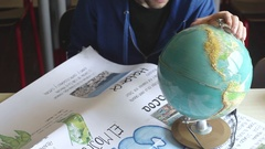 Student touching world map Stock Footage