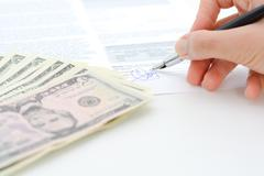 Sign a contract or agreement with a pen Stock Photos