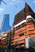 Skyscraper under construction urban area against blue sky Stock Photos