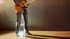 Guy Plays Guitar in Studio Taps Heels at Bright Light Stock Footage