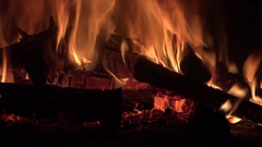 Open fire in oven on black background 4k Stock Footage