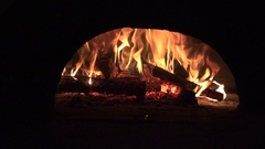 Wood burning oven for cooking food in an old house 4k Stock Footage