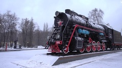 Old vintage restored steam locomotive standing in the snow in Moscow Stock Footage