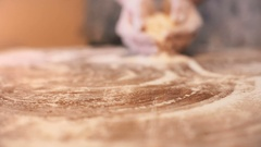 Woman's hand prepping a surface with flour. Stock Footage