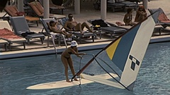 Phuket, Thailand 1982: woman windsurfing in the swimming pool Stock Footage