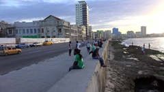 Cubans are resting on the Malecon Havana at sunset. Stock Footage