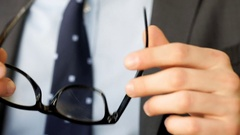Businessman's hands holding and touching glasses Stock Footage