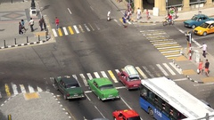 Road traffic with old American cars at the Central Havana, Cuba Stock Footage
