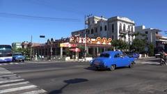 Road traffic with old American cars.  Vedado, Havana, Cuba Stock Footage