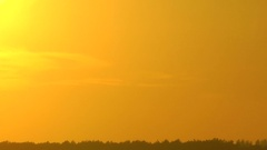 Bright sun in an environment of shapeless clouds is rolled up for the horizon. Stock Footage