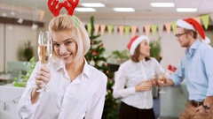 Beautiful young businesswoman rises her glass to make a toast Office party on Stock Footage