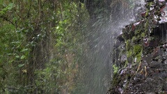 Small waterfall splashing down a rock face Stock Footage