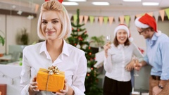 Close up of young succesful businesswoman giving gift Office party on background Stock Footage