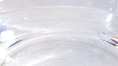 Slice of Lime splashing into water Stock Footage