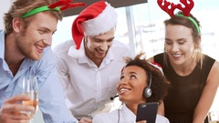 Cheerful colleagues reading greetings on phone screen Slow motion Stock Footage