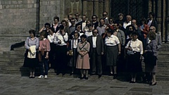 Moscow 1984: tourists while pose for a group photo Stock Footage