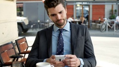 Worried businessman looking on smartphone and having problem, steadycam shot Stock Footage