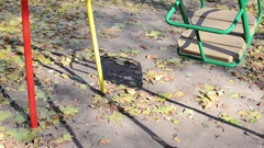 Empty metal swing rocking back and forth. Stock Footage