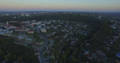 Camera flies toward Kamianets-Podilski at dusk Stock Footage