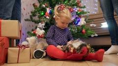Little girl under Christmas tree Stock Footage
